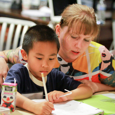 Woman tutors young boy
